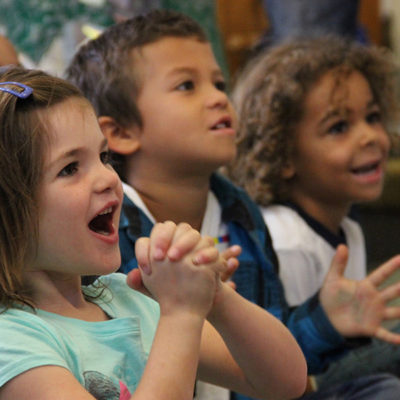 photo of adorable children listening to story time at the public library